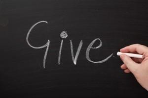 The word give written on blackboard
