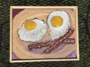 Fairbanks's painting of fried eggs and bacon forming a smiling face
